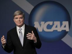 "NCAA President Mark Emmert addresses deligates to the annual convention on Thursday. He later said he thinks the idea of a four-team playoff is ""sound."""