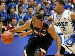 Virginia guard Jontel Evans, left, here driving past Duke guard Quinn Cook, came up short on a shot that would have tied the game at the end of regulation.