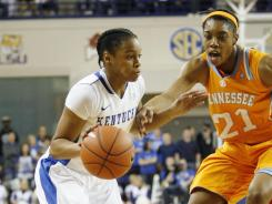 Guard A'dia Mathies, left, had a career-high 34 points to help No. 8 Kentucky slip past No. 7 Tennessee.