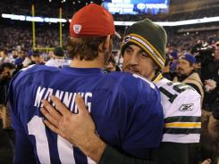 Aaron Rodgers, right, and EliManning share a word after the two combined for seven TD passes in the Packers' 38-35 win Dec. 4.