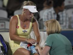"Caroline Wozniacki had to get treatment on her left wrist during her quarterfinal loss to Agnieszka Radwanska in Syndey on Wednesday. A WTA spokeswoman said it's ""hopeful"" the No. 1 player in the world will play in Melbourne."