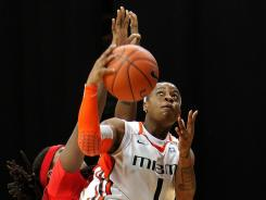Miami guard Riquna Williams drives to the basket against Maryland center Lynetta Kizer in the first half at the BankUnited Center. Williams had eight three-pointers to lead the Hurricanes to victory.