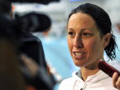 Janet Evans won her preliminary heat in the 400-meter freestyle in 4:17.27, easily beating the Olympic trials qualifying standard by over two seconds.