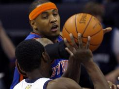 New York Knicks forward Carmelo Anthony, with the headband, was hurt in Thursday's loss to the Memphis Grizzlies and is doubtful for the next game.