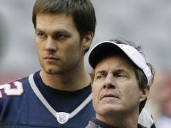 New England Patriots quarterback Tom Brady, left, and coach Bill Belichick face Denver with an AFC Championship berth on the line.