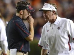John Butler, left, served as Steve Spurrier special teams coach at South Carolina in 2011, but has opted to join Bill O'Brien at Penn State.