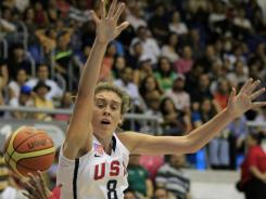 Breanna Stewart, of the United States, top, tries to block Puerto Rico's Carla Cortijo during a women's basketball match at the Pan American Games in Guadalajara, Mexico. Stewart the top recruit in the country, was the only high school player on Team USA.