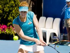 Mona Barthel plays a backhand return during her 6-0, 7-6 (8-6) victory over Angelique Kerber.
