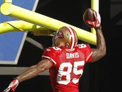 49ers tight end Vernon Davis celebrates after scoring a touchdown during the first quarter at Candlestick Park. Davis scored the game-winning touchdown in the dying moments of the fourth quarter.