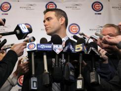 Team  president Theo Epstein gets questioned at a news conference during the 27th annual Cubs Convention in Chicago on Friday.