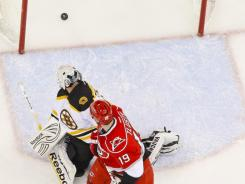 Hurricanes center Jiri Tlusty (19) watches as teammate Jay Harrison's shot goes past Bruins goalie Tim Thomas (30) for the game-winning goal in the third period at the RBC Center.
