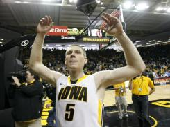 Iowa guard Matt Gatens celebrates beating Michigan on Saturday. Gatens scored 19 points to lead Iowa.