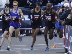 From left to right, Dathan Ritzenhein, Ryan Hall, Mohamed Trafeh, Abdi Abdirahman and Meb Keflezighi run through a turn during the U.S. Olympic Trials Marathon on Saturday in Houston.