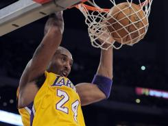 Kobe Bryant dunks home two of his 42 points in the Lakers' fifth consecutive win.