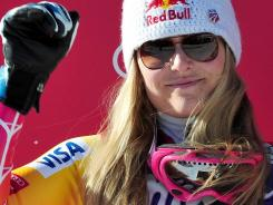 American Lindsey Vonn gestures on the podium after the FIS World Cup women's downhill, on Saturday in Cortina d'Ampezzo. She finished second.