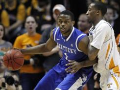 Kentucky's' Darius Miller made two critical free throws  the final 20 seconds of Saturday's game to help the Wildcats squeak past Tennessee.
