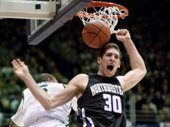 Northwestern forward Davide Curletti, right, reacts after dunking on Michigan State center Adreian Payne during the second half of a college basketball game on Jan 14, 2012 in Evanston, Ill. Northwestern won 81-74.