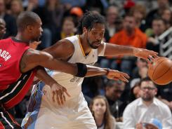 Nene, right, had 17 points and 12 rebounds, and Denver sent Chris Bosh and Miami to their third loss in a row.
