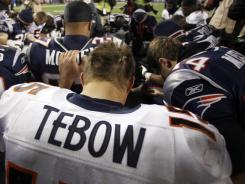 As Tim Tebow's Broncos fell behind the Patriots, the quarterback cooled on social media sites.