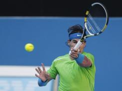 Rafael Nadal of Spain runs down a forehand during his victory against Alex Kuznetsov of the USA on Monday.