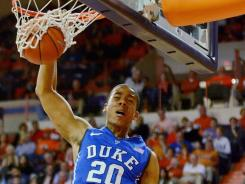 Duke's Andre Dawkins jams over Clemson's Bernard Sullivan during the first half. Dawkins' game-high 24-points paved the way for the Blue Devils' 15th win.