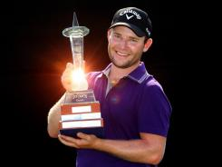 ORG XMIT: 135867709 JOHANNESBURG, SOUTH AFRICA - JANUARY 15: Branden Grace of South Africa shows off his trophy after winning the Joburg Open.
