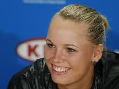 Caroline Wozniacki of Denmark smiles for the cameras during a news conference in Melbourne. The world No. 1 is chasing her first Australian Open, and major, title.