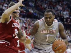 Ohio State's Deshaun Thomas, right, drives to the basket against Indiana's Derek Elston during the second half.