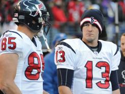 Houston Texans tight end Joel Dreessen (85) and quarterback T.J. Yates (13) wait out the final seconds of their 20-13 loss to Baltimore.