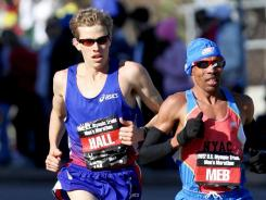 From left, Meb Keflezighi, Ryan Hall and Abdi Abdirahman compete in the U.S. Marathon Olympic Trials on Saturday in Houston.
