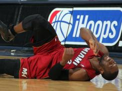 Guard Dwyane Wade hurt his ankle in the Heat's loss on Friday to the Nuggets.