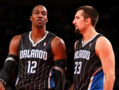 Magic star Dwight Howard (12) was limited to eight points, but Ryan Anderson (33) picked up the slack with a career-high 30.