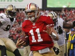 Alex Smith rallied the 49ers past the Saints with a touchdown run and a TD pass in the closing minutes.