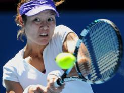 Li Na hits a return against Ksenia Pervak during their first round singles match at the Australian Open in Melbourne. Na won the match.
