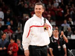 Ohio State and North Carolina are making huge increases over the amounts they paid in 2011 to short-term coaches, who were paid far less than what those schools had been paying in prior seasons. New Ohio State coach Urban Meyer is pictured here.