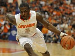 Syracuse guard Dion Waiters dribbles against Pittsburgh during the first half at the Carrier Dome.