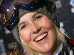 In this Jan. 23, 2009 file photo, Sarah Burke, of Canada, holds her gold metal after winning the Women's Superpipe event at Winter X Games 13 at Buttermilk Ski Area, near Aspen, Colo.