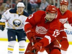 Pavel Datsyuk (13) had three assists as the Red Wings set a team record with their 15th consecutive home win with their 5-0 triumph over the Sabres on Monday.