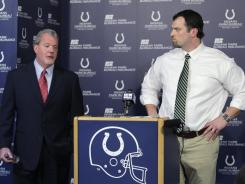 Indianapolis Colts owner Jim Irsay, left, speaks during a news conference as general manager Ryan Grigson listens. The Colts announced the firing of coach Jim Caldwell.