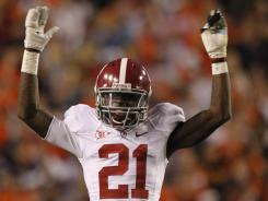 In this Nov. 26, 2011, file photo, Alabama defensive back Dre Kirkpatrick reacts in the second half of a NCAA college football game against Auburn at Jordan-Hare Stadium in Auburn, Ala. Kirkpatrick has been arrested on a marijuana possession charge.