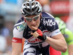 Andre Greipel of Germany and team Lotto-Belisol gestures after winning the stage in a photo finish at the 2012 Tour Down Under on Tuesday in Adelaide, Australia.