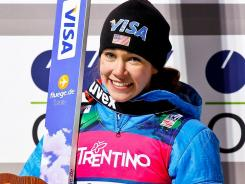 Sarah Hendrickson poses after winning the FIS women's ski jumping World Cup in Val di Fiemme, Italy.