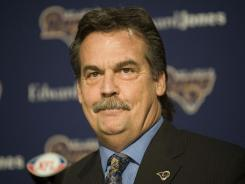 Jeff Fisher signed a five-year deal to coach the Rams on Tuesday.