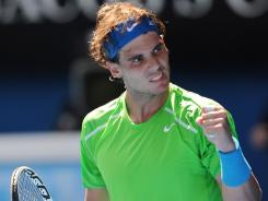 Spain's Rafael Nadal celebrates after defeating Germany's Tommy Haas in their second round match at the Australian Open in Melbourne.