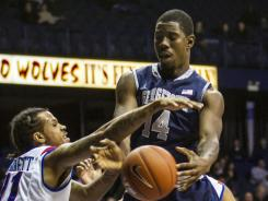 DePaul's Jamee Crockett knocks ball out of the hands of Georgetown's Henry Sims (14) during the second half in Rosemont, Ill.