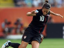 After Carli Lloyd, top, and Team USA's successful run in the Women's World Cup, there is an intense focus on the qualifying tournament for the London Olympics. Team USA's first game is on Friday.