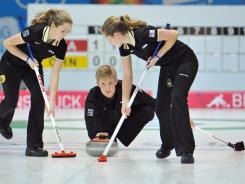 Team USA's Tom Howell looks on as his teammates Taylor Anderson, left, and Sarah Anderson work on the stone while playing against China during a mixed team curling event Tuesday at the Winter Youth Olympics in Innsbruck, Austria.