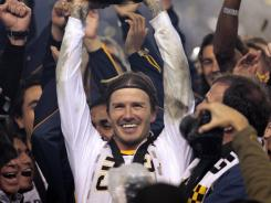 David Beckham, center, celebrates after the Galaxy  won the 2011 MLS Cup.