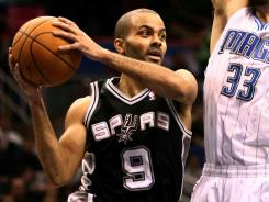 Tony Parker scored 16 points in the fourth quarter and overtime as the Spurs picked up their first road win of the season.