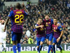 Barcelona's Eric Abidal (22) celebrates after scoring the game-winner against Real Madrid at the Santiago Barnabeu in Madrid.